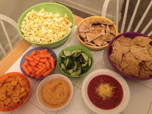 Popcorn, veggies and pita chips with roasted red pepper hummus, black bean and garlic tortilla chips and salsa and Cheeze its!